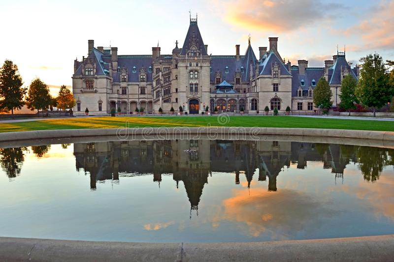 Sunset at Biltmore Estate Mansion and reflecting pool, Asheville NC. Biltmore Estate is a large private estate and tourist attraction in Asheville, North royalty free stock image