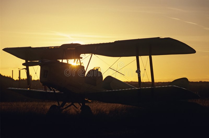 Sunset on biplane Tiger Moth. Sunset on an aircraft Biplane De Havilland Tiger Moth DH-82 royalty free stock images