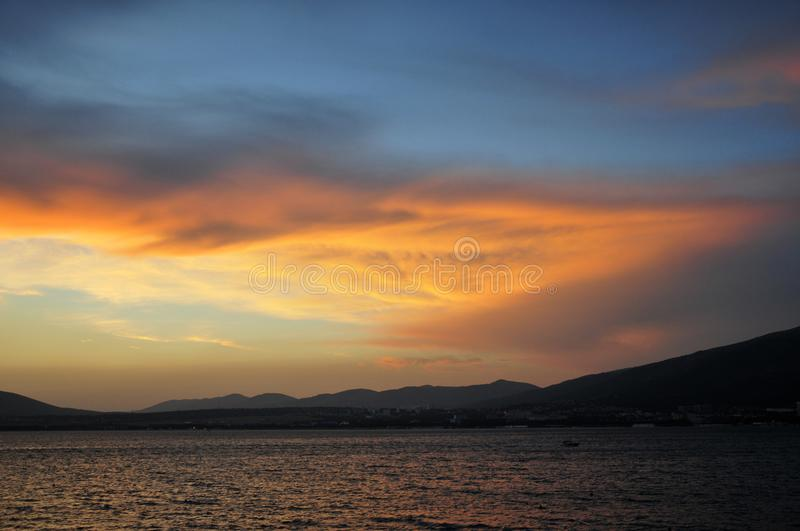 Sunset on the black sea and blue with yellow sky,very intensive colors stock photos