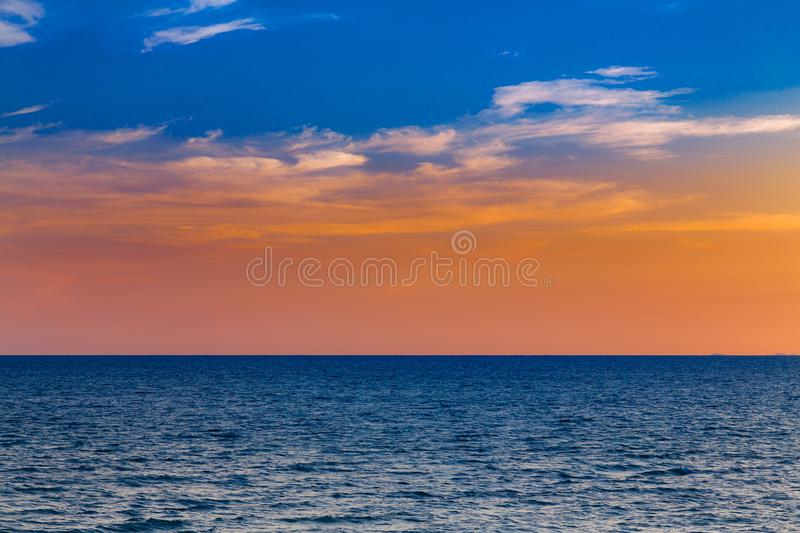After sunset blue and orange colour sky and ocean. Natural landscape background royalty free stock images