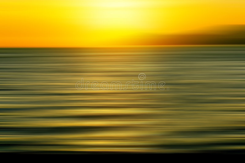 Sunset blur. Beautiful bright ocean sunset blur royalty free stock image