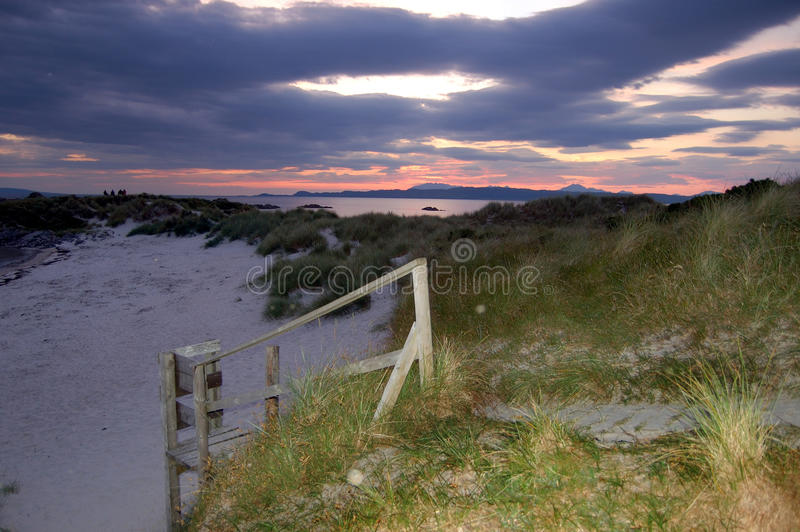 Sunset and boardwalk at Arisaig. Looking over toward the island of Skye, Scotland stock images