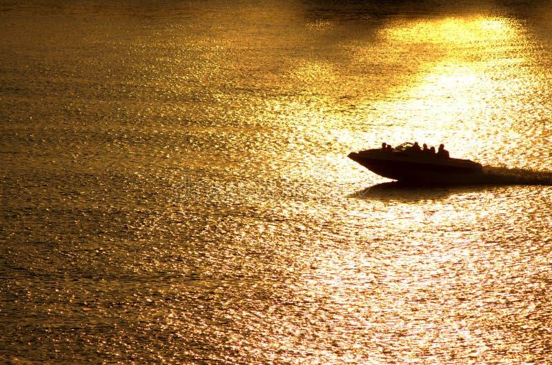 Sunset boat ride stock photo