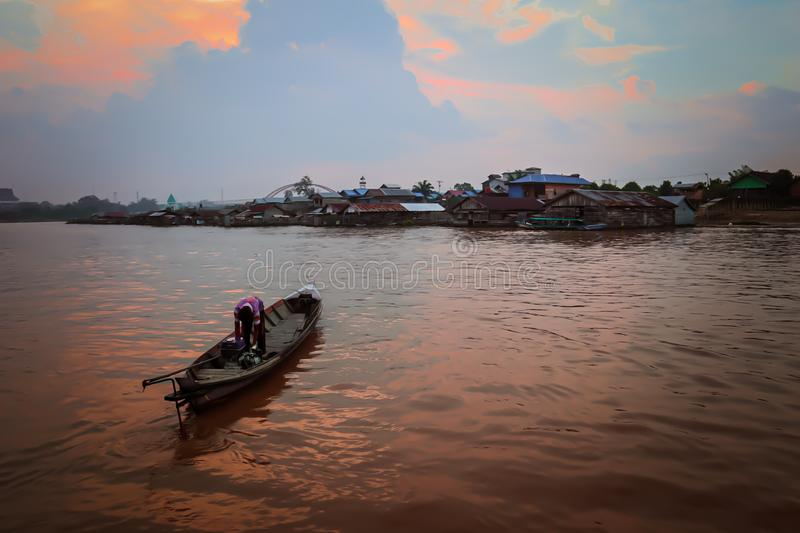 Sunset. Boat in river Kahayan Palangka Raya city. Walking by boat is great for seeing the scenery along the river especially in the afternoon royalty free stock photos