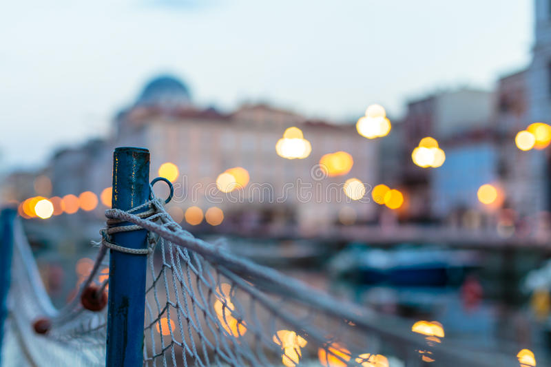 Sunset from a boat in Trieste. Sun goes down in the city of Trieste stock image