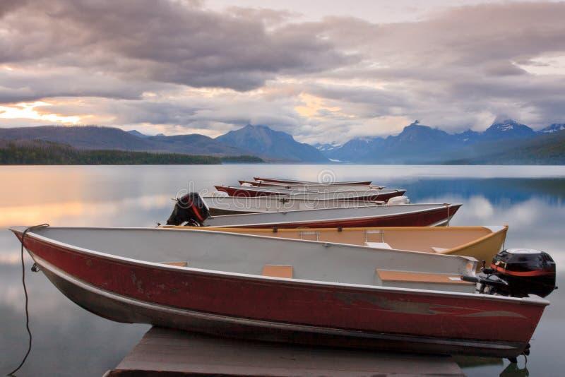 Sunset Boats on Lake McDonald, Glacier stock photo
