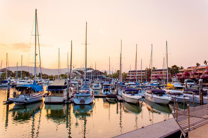 Sunset with boats and yacht at harbor royalty free stock photo