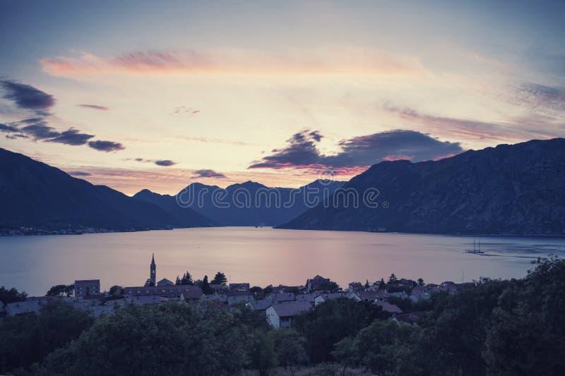 Sunset at Boka Kotorska bay. With majestic clouds, vintage travel landscape, Dobrota, Montenegro royalty free stock photography