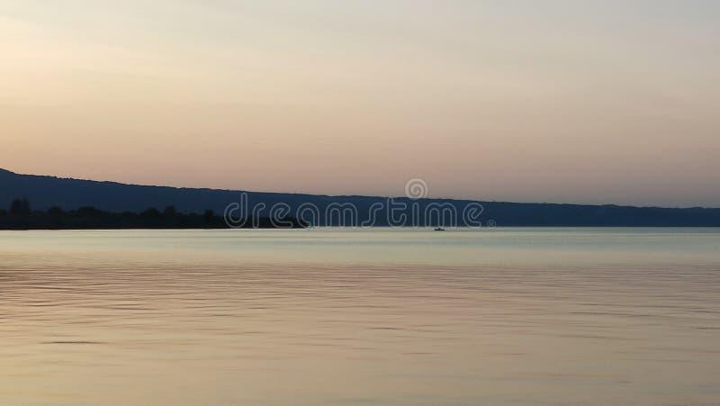 Sunset on the bolsena Lake, with boat. Sunset on the bolsena Lake, with a boat royalty free stock image