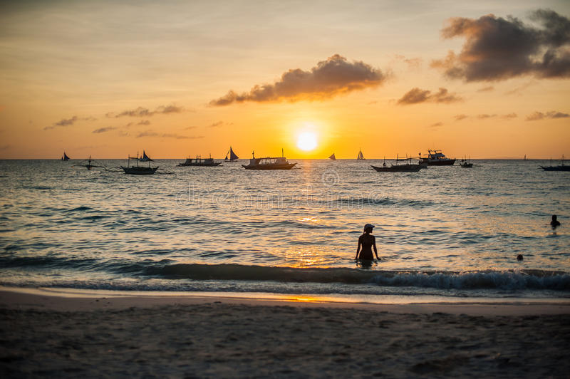 Sunset in Boracay, boat, girl. White beach royalty free stock photography