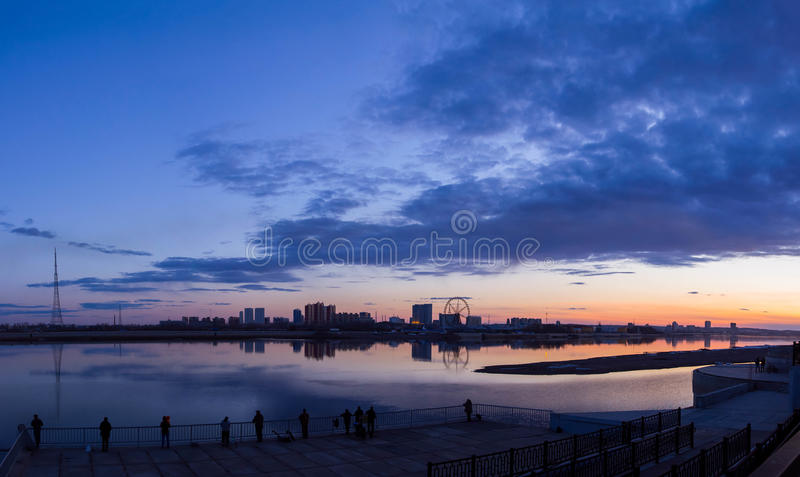 Sunset on the border of the river royalty free stock photography