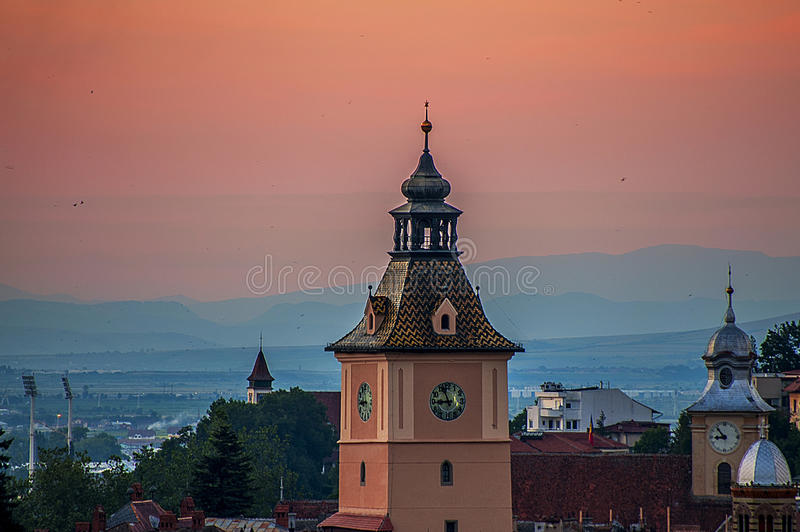 Sunset with towers. Beautifull sunset with towers and birds royalty free stock photo