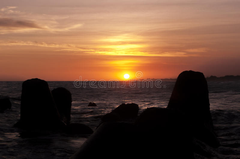 Sunset and breakwaters at Glagah beach, Yogyakarta, Indonesia. Glagah is one of the most famous beaches in Kulon Progo. We can fishing, biking, climbing cano in royalty free stock images