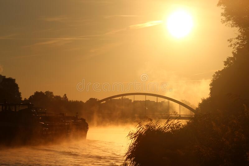 Sunset and Bridge Over River stock image