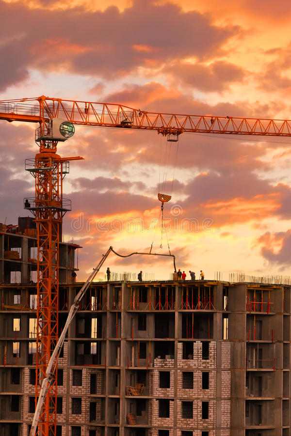 Sunset building. Construction work site on the sunset background stock images