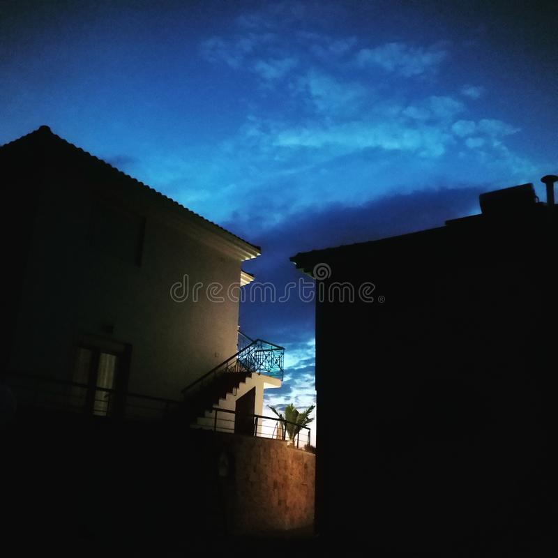Sunset between buildings in Halkidiki Greece at the summer royalty free stock image