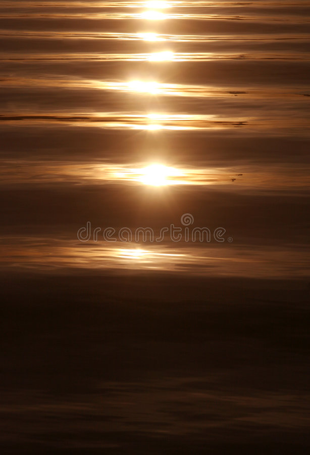 Sunset on a calm sea royalty free stock photo