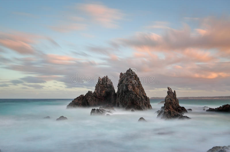 Sunset at Camel Rock. Sunset and long exposure to draw out all the colour in the clouds as the afternoon sun sets to the west at Camel Rock, Australia. The stock images