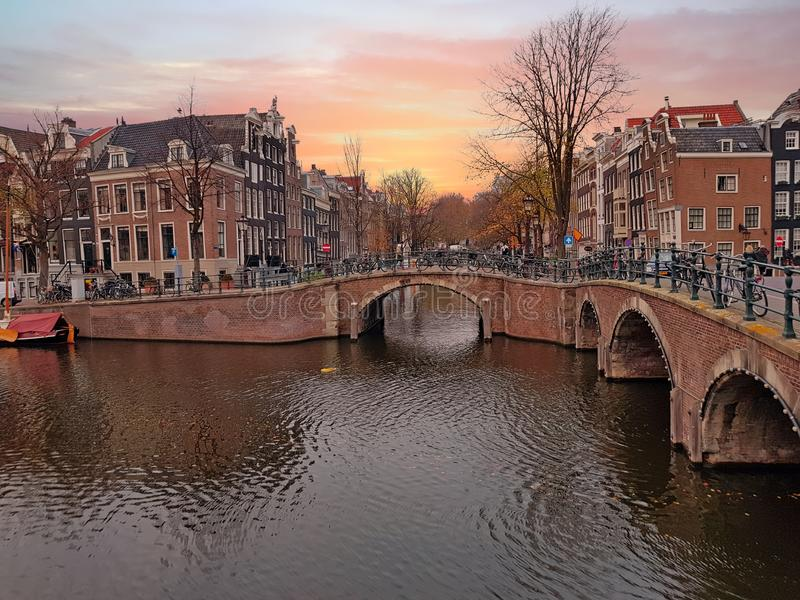 Sunset at the canals in Amsterdam the Netherlands royalty free stock images