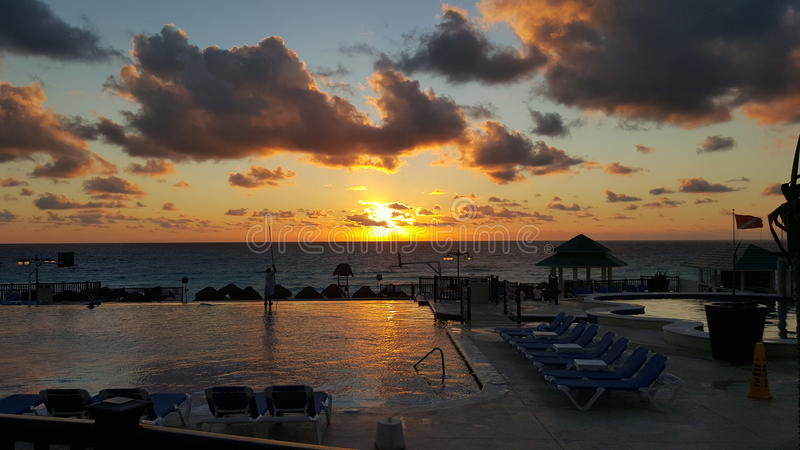 Sunset in Cancun Mexico. I took this picture in Cancun, Mexico and it shows a beautiful sunset with the ocean as the background royalty free stock photo