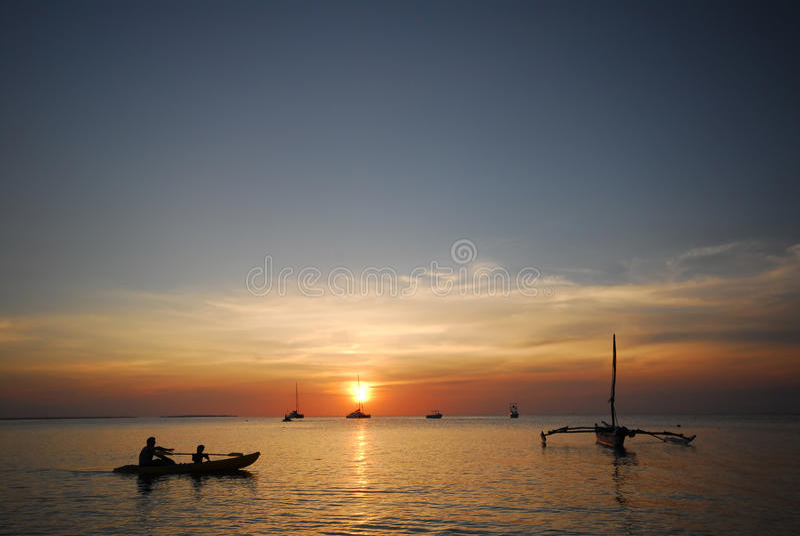 Sunset Canoeing Stock Images