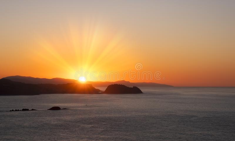 Sunset in the Cantabrian Sea, coast of Gipuzkoa with the sun hiding behind Getaria. Sunset in the Cantabrian Sea, coast of Gipuzkoa with the sun hiding behind stock photo