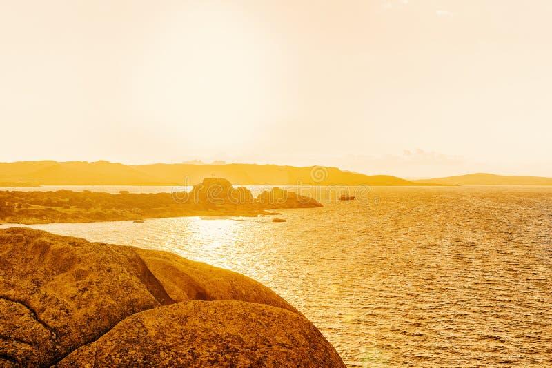 Sunset at Capo Ferro at the Mediterranean Sea. In Costa Smeralda in Sardinia in Italy royalty free stock image