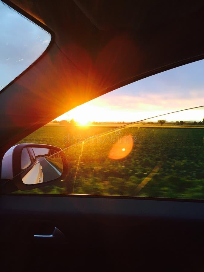 Sunset from car window stock photos