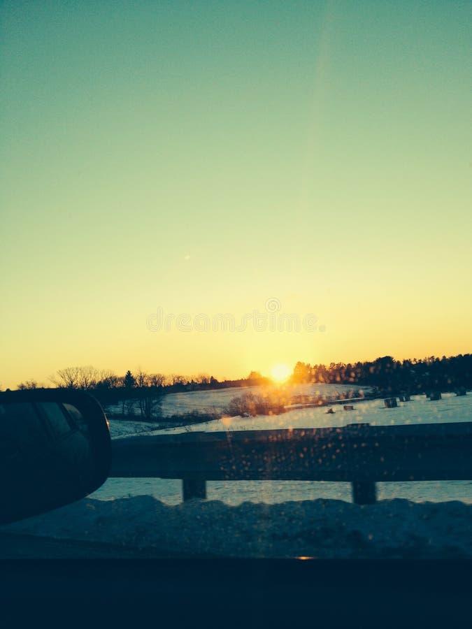Sunset through car window royalty free stock photo