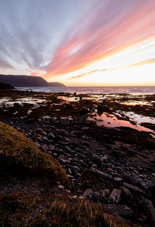 Colour and texture at Sunset in Rocky Harbour. Sunset casting soft pastels over the rocky shores of a Newfoundland Harbour near Gros Morne National Park in royalty free stock photos