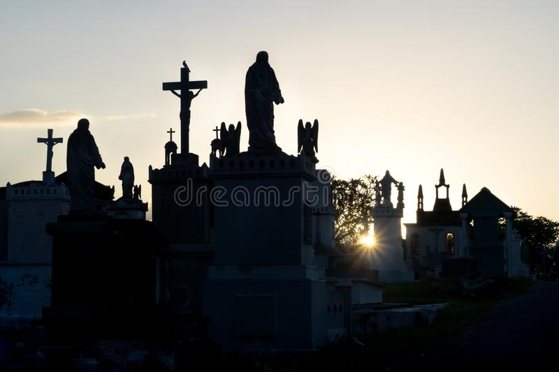 Sunset at Cementerio General with backlight and silhouettes of the tombs, Merida, Mexico. Sunset at cemetery with backlight and silhouettes of the tombs with royalty free stock image