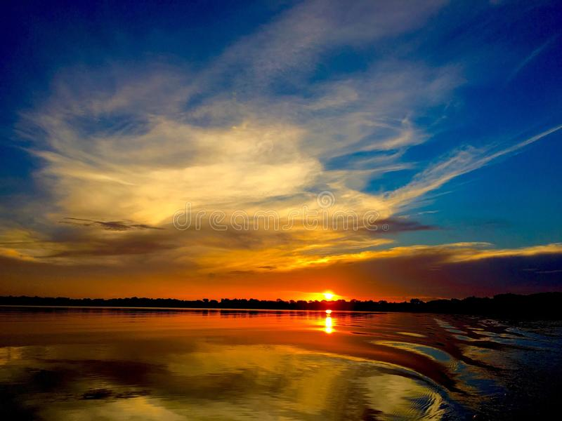Sunset at Chain of Lakes in Winter Haven. Sunset from a boat on the Chain of Lakes in Winter Haven, Florida royalty free stock photo