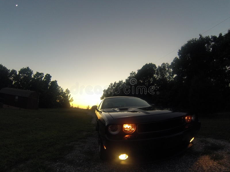 Sunset Challenger. Dodge Challenger at sunset stock photo
