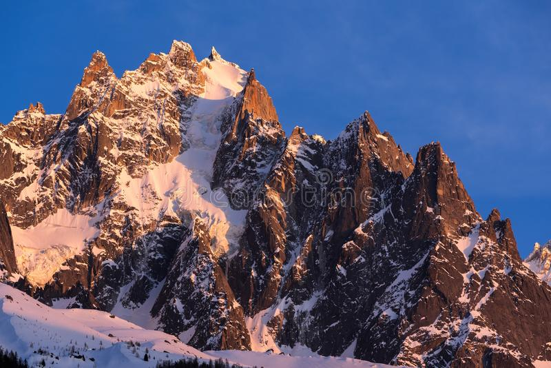 Sunset on the Chamonix Needles.Mont Blanc mountain range, Chamonix, Haute-Savoie, Alps, France. Sunset on the Chamonix Needles Aiguille du Plan and Dent du stock photo