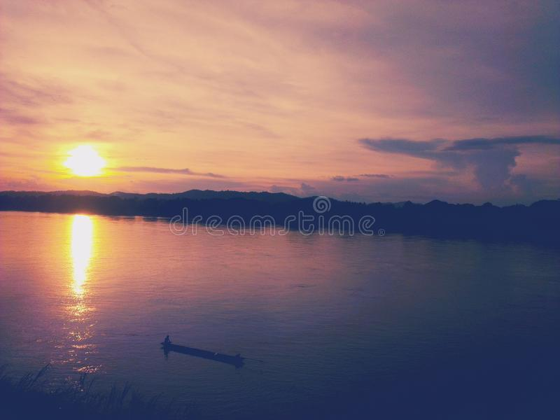 Sunset at Chiang Khan on the Mekong River. Sunset at Chiang Khan district, Thailand along the Mekong River royalty free stock photography