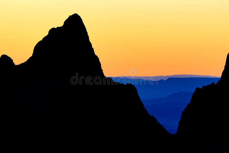 Sunset in chisos basin big bend texas usa. Outline of a ountain top in the sunset light in chisos basin in big bend national park texas stock photo