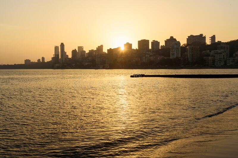 Sunset on Chowpatty beach in Mumbai. India. Sunset on Chowpatty beach. View of Malabar hill in Mumbai. India stock images