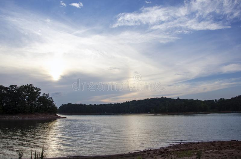 Sunset and Cirrus Clouds over Tugaloo State Park Georgia. Blue sky evening sunset reflecting off water of Lake Hartwell at Tugaloo State Park, Franklin County stock images