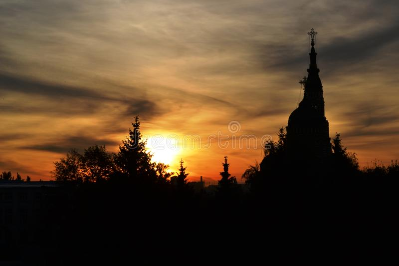 Sunset in the city, with dark trees and a church2 royalty free stock photos