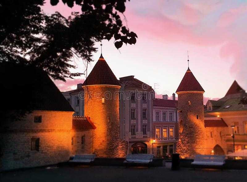 Sunset in the city evening medieval old town of Tallinn towers park at night city light bench trees sky. Tallinn Estonia Travel ,Autumn evening in city street stock photography