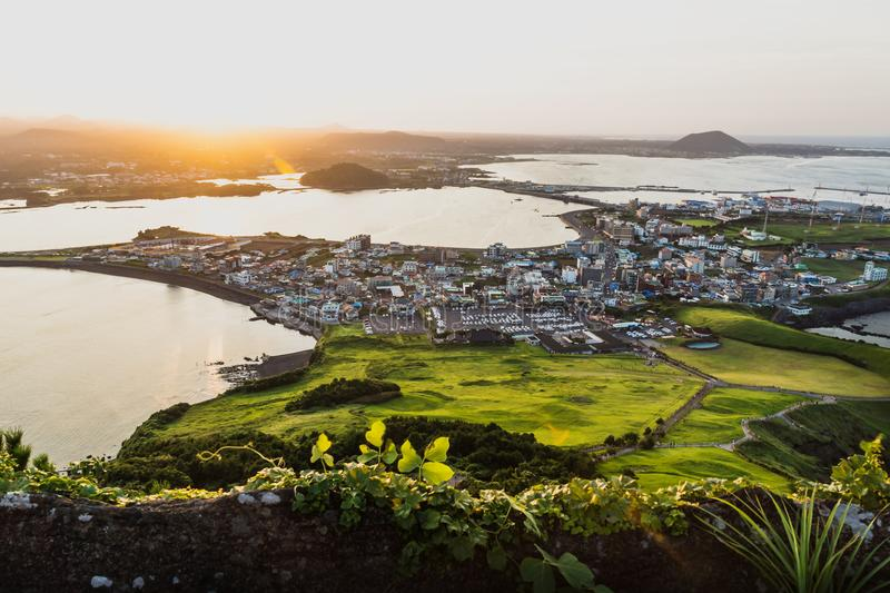 Sunset city view from Ilchulbong peak to Seongsan, Jeju Island, South Korea royalty free stock photography