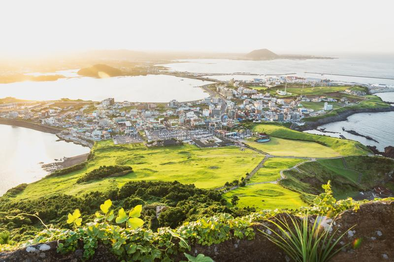 Sunset cityscape view from Ilchulbong peak to Seongsan, Jeju Island, South Korea royalty free stock photos