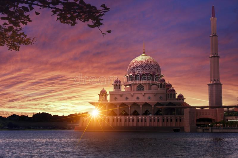 Sunset at the Classic Mosque. Beautiful and warm sunset over Putrajaya mosque viewed from the river stock photography