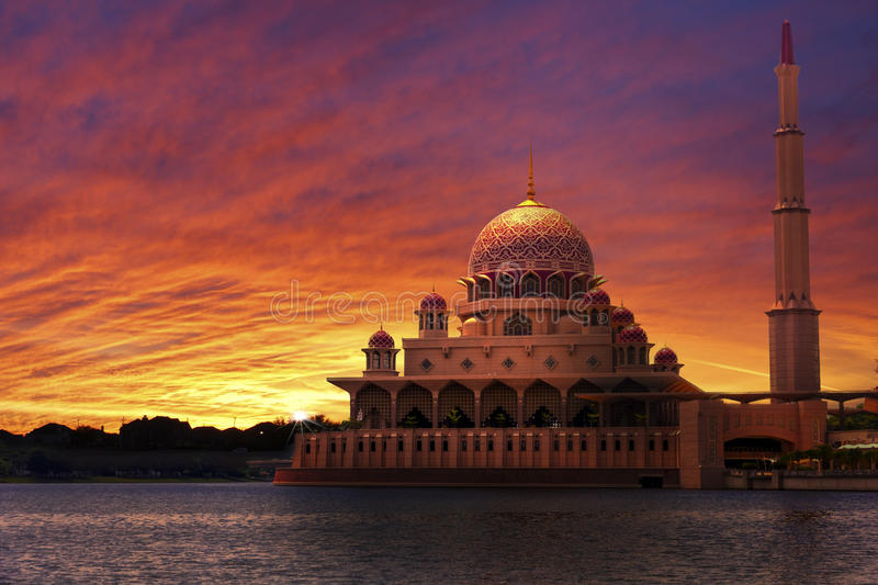 Sunset at the Classic Mosque. Beautiful and warm sunset over Putrajaya mosque viewed from the river