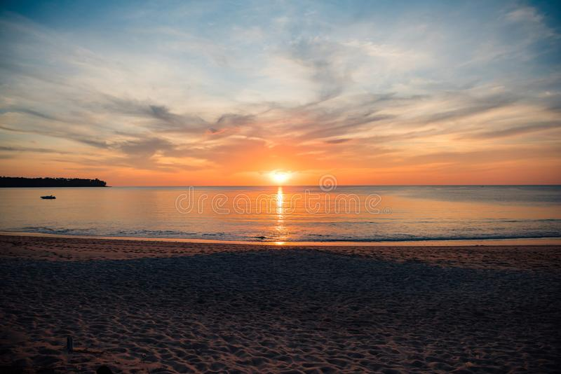 Sunset, clear day on a beach on Phuket Island, Thailand brings calm sea. With only a small wave Send light to the beach, the beach royalty free stock photo