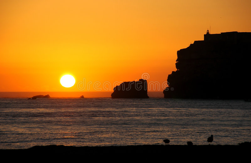 Sunset with cliffs royalty free stock photo