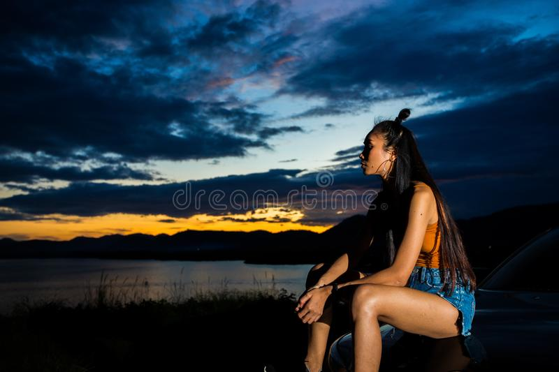 Sunset cloud beam to young adult asian woma stock images
