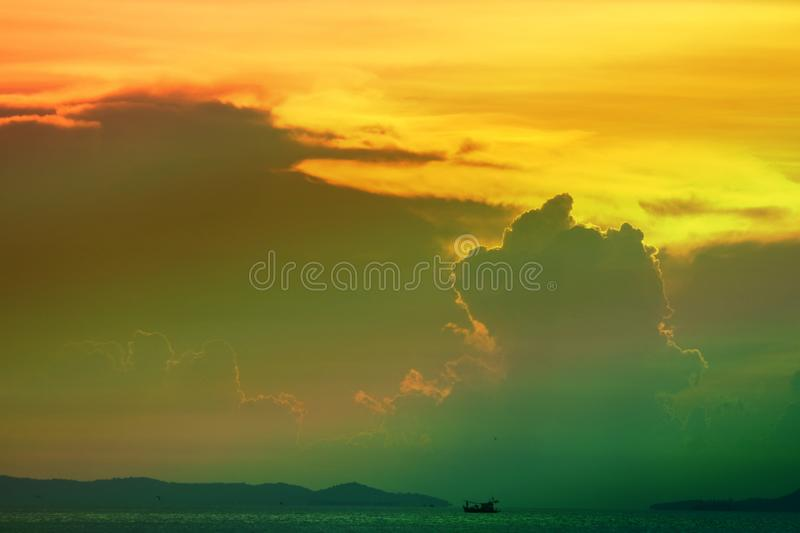 sunset cloud on silhouette sky fishing boat on island and sea stock photo