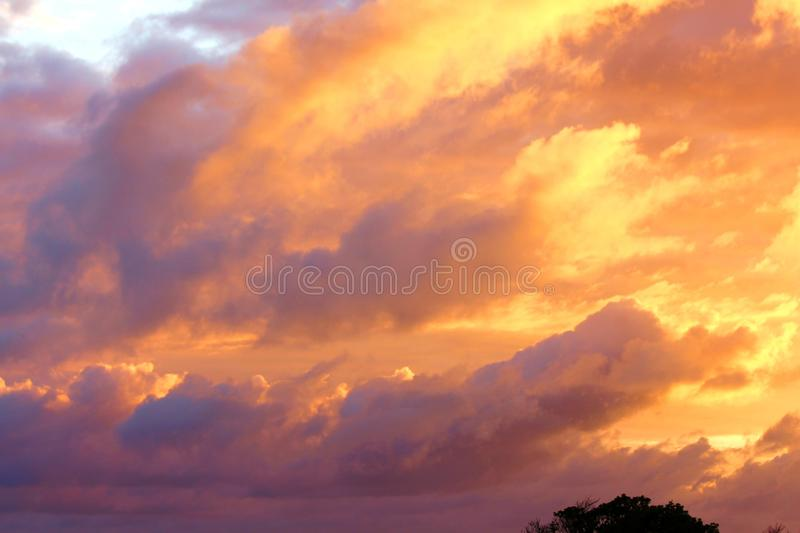 Sunset Clouds. The dawn has its own splendours, but it brightens out of secret mists and folded clouds into the common light of day, when the burden must be royalty free stock photos