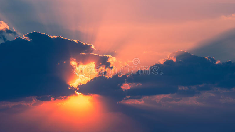 Sunset into clouds stock images
